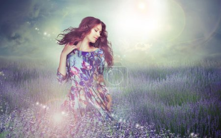 Fantasy. Woman in Enigmatic Meadow over Cloudy Sky