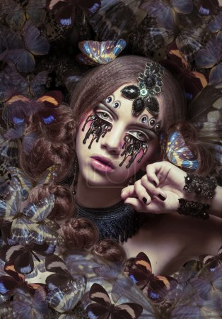 Inspiration. Woman with Fantastic Teardrops and Butterflies