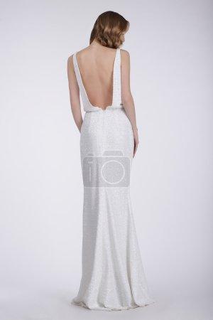Rear View of a Woman in White Long Dress