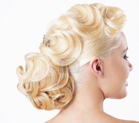 Elegance. Rear View of Blonde with Festive Hairstyle