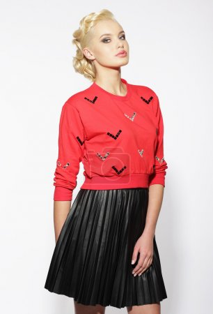 Trendy Blond in Red Blouse and Black Skirt