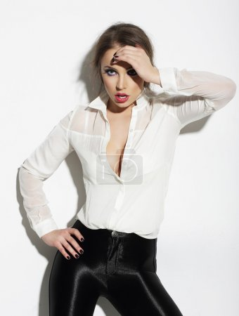 Elegant Young Woman in White Blouse Gesturing