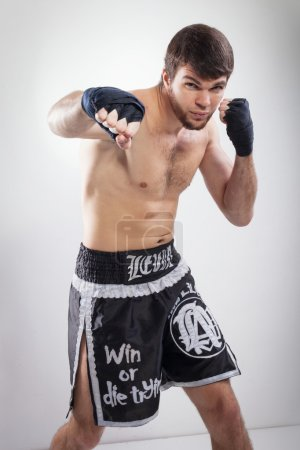Photo for Thai boxing Artem Levin in studio - Royalty Free Image