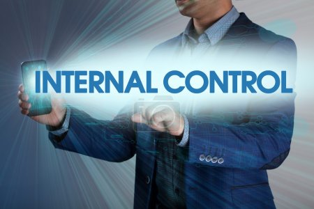 Businessman presses button internal control on virtual screens.