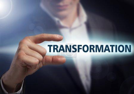 Businessman presses button transformation on virtual screens. Bu