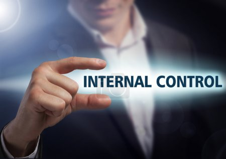 Businessman presses button internal control on virtual screens.