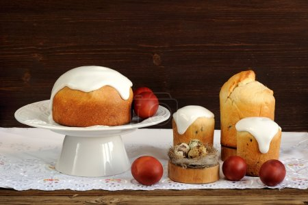 Kulichi, traditional Russian easter cakes, dyed eggs and bird ne