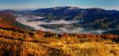 View of misty fog mountains in autumn, Carpathians, Ukraine