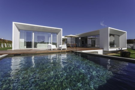 Photo for Modern house with garden swimming pool and wooden deck - Royalty Free Image