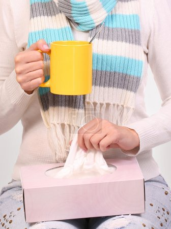 Photo for Flu cold. Sick woman with cup of tea and tissue box. Closeup - Royalty Free Image