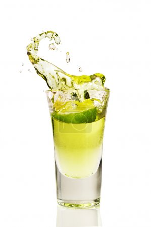 Photo for Splash of tequila from the falling pieces of lime isolated on white - Royalty Free Image