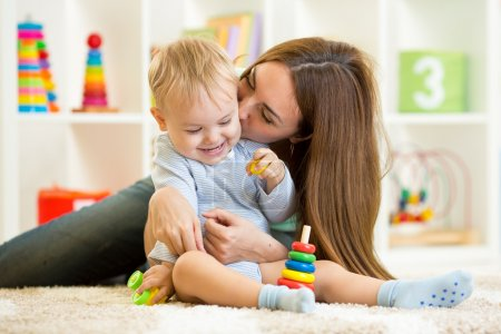 Happy mother and child son playing  indoor at home
