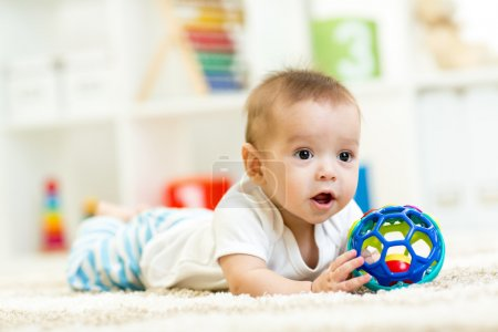Baby boy playing with toy indoor
