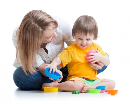 Kid and mother playing with toys