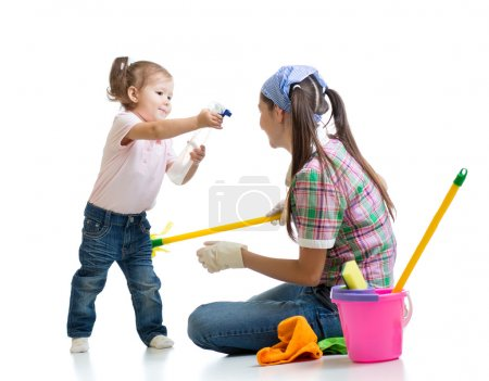 mom with child cleaning room and having fun