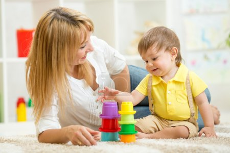 mom and child playing block toys at home