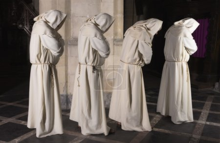 Four monks in a row