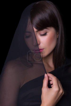 Black veiled woman
