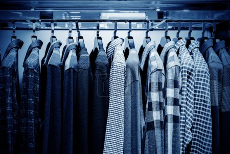 Photo for Mens plaid shirts on hangers in a retail store - Royalty Free Image