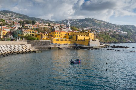 Promenade of Funchal with the castle of Sao Tiago,...