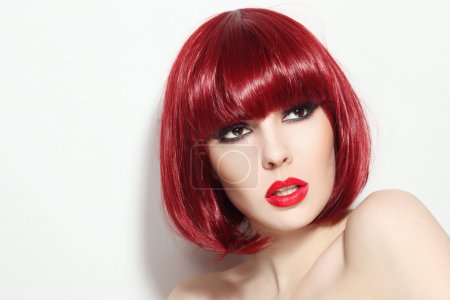 Photo for Portrait of young beautiful sexy red-haired girl with bob haircut and stylish make-up looking upwards - Royalty Free Image