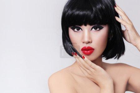 girl with bob haircut and red lipstick