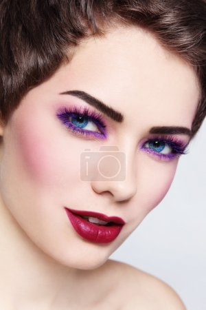 Photo for Close-up portrait of young beautiful smiling woman with stylish violet make-up - Royalty Free Image