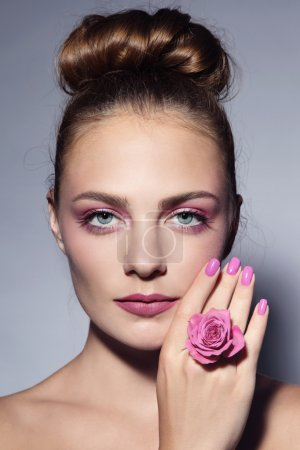girl with pink manicure and hair bun