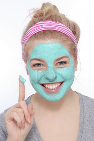 young blond girl with face mask