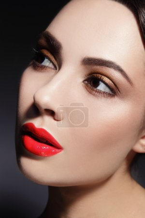 woman with red lips and stylish make-up