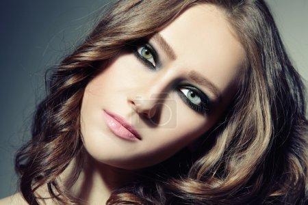 woman with stylish smoky eyes