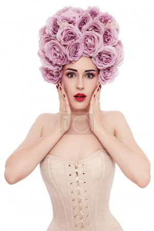 woman in corset with fancy wig of roses