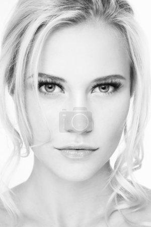 blonde girl with extended eyelashes