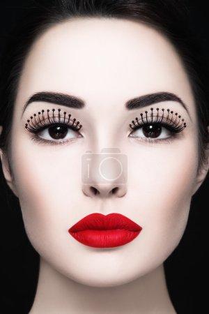 woman with fancy false eyelashes
