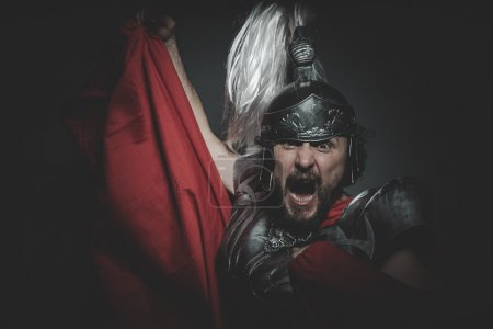 Roman legionary in  red cloak