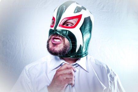 businessman wearing  Mexican wrestler mask