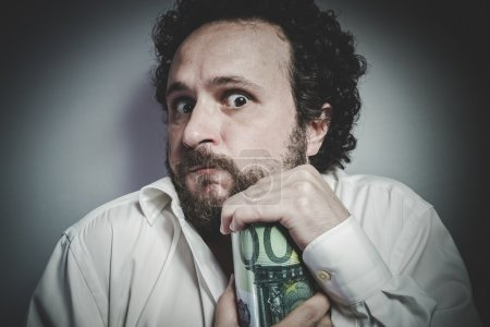 Photo for Man in white shirt holding money box with face expression - Royalty Free Image