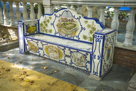 beanch decorated with  tile pieces