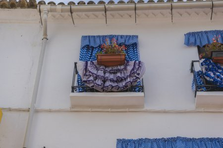 balconies with flamenco dresses in Marbella