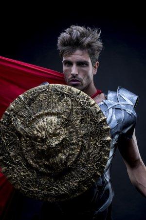 Epic, centurion or Roman warrior with iron armor, military helme