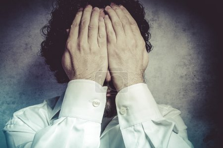 Businessman covering his eyes, man in white shirt ...