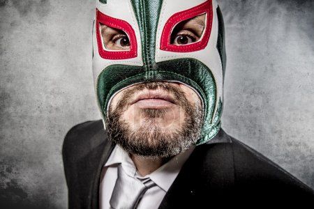 Businessman with Mexican wrestler mask