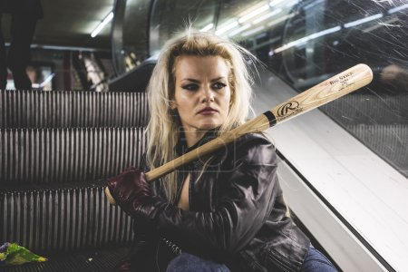 Beautiful blonde with a baseball bat