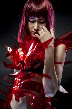Beautiful, asian woman in abstract clothing