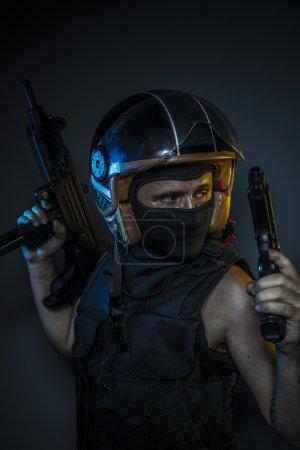 murderer holding  guns