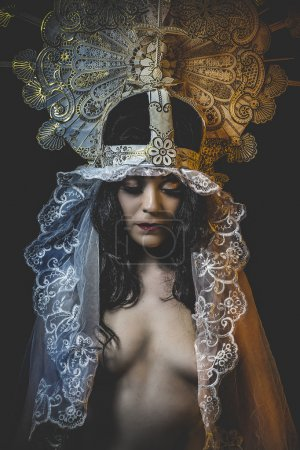 woman with white headdress and gold crown