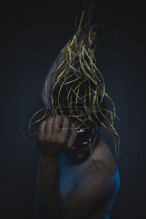 Photo for Dramatic, depression and anxiety, naked man with a crown of thorns on his head - Royalty Free Image