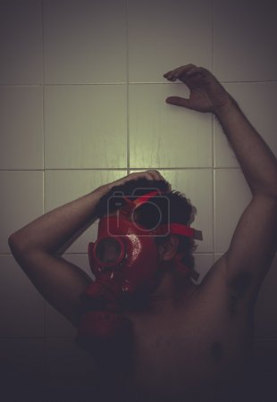 Photo for Frustration, desperate man, anguish and suffering with red gas mask - Royalty Free Image