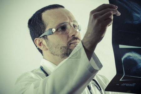Radiologist looking at an x-ray