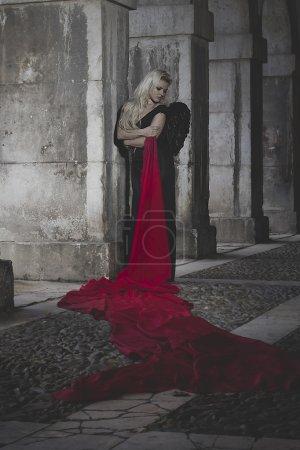 Blonde woman dressed in black dress